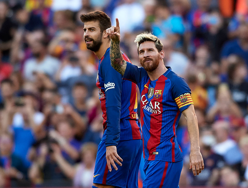 BARCELONA, SPAIN - OCTOBER 15:  Lionel Messi of FC Barcelona celebrates scoring his team's fourth goal with his teammate Gerard Pique during the La Liga match between FC Barcelona and RC Deportivo de La Coruna at Camp Nou stadium on October 15, 2016 in Barcelona, Spain.  (Photo by Manuel Queimadelos Alonso/Getty Images)