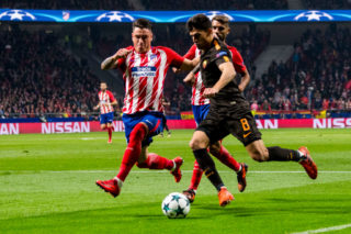 MADRID, SPAIN - NOVEMBER 22: Diego Perotti (r) of AS Roma fights the ball with Jose Maria Gimenez de Vargas of Atletico de Madrid  during the UEFA Champions League 2017-18 match at Wanda Metropolitano on 22 November 2017 in Madrid, Spain. (Photo by Power Sport Images/Getty Images)