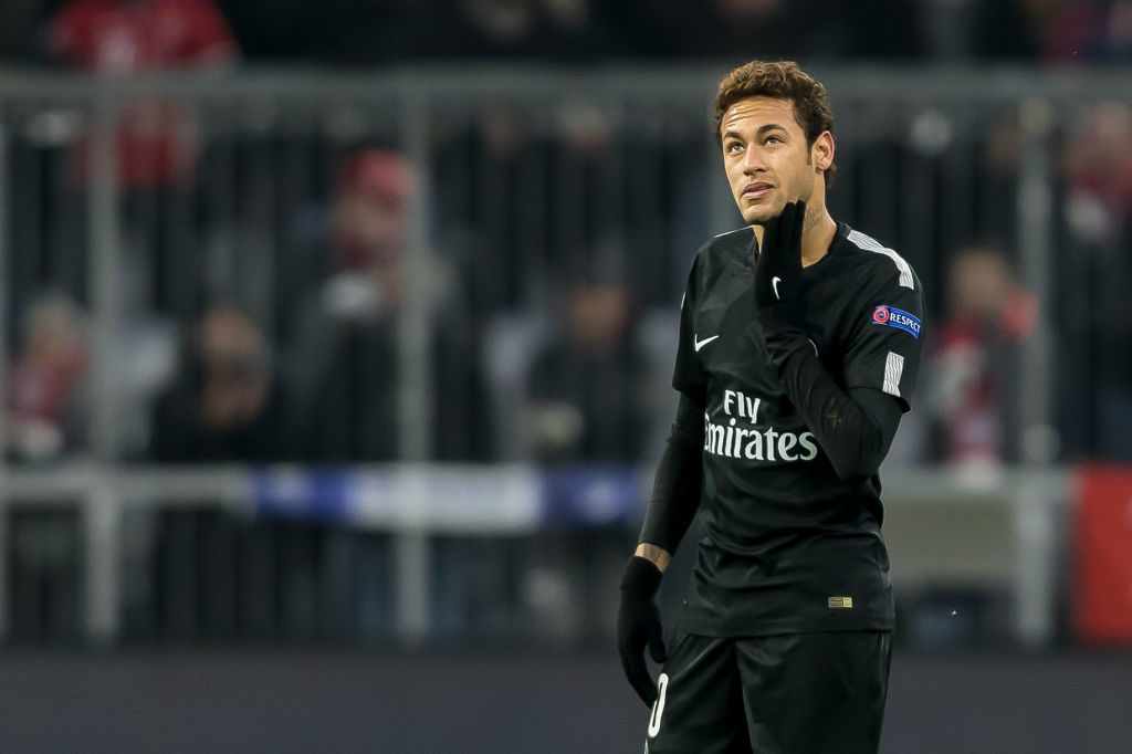 MUNICH, GERMANY - DECEMBER 05: Neymar of Paris Saint-Germain looks on during the UEFA Champions League group B match between Bayern Muenchen and Paris Saint-Germain at Allianz Arena on December 5, 2017 in Munich, Germany. (Photo by TF-Images/TF-Images via Getty Images)