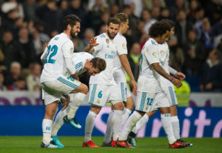 MADRID, SPAIN - NOVEMBER 05: Isco Alarcon of Real Madrid CF celebrates with Sergio Ramos after scoring his team's 3rd goal during the La Liga match between Real Madrid and Las Palmas at Estadio Santiago Bernabeu on November 5, 2017 in Madrid, Spain. (Photo by Denis Doyle/Getty Images)
