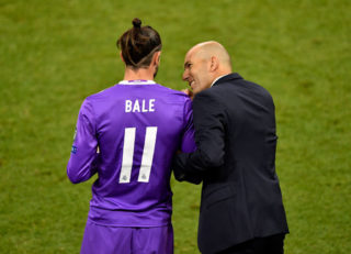 CARDIFF, WALES - JUNE 03:  In this handout image provided by UEFA, Zinedine Zidane, Manager of Real Madrid speaks to Gareth Bale of Real Madrid before he is subbed on during the UEFA Champions League Final between Juventus and Real Madrid at National Stadium of Wales on June 3, 2017 in Cardiff, Wales.  (Photo by Handout/UEFA via Getty Images)