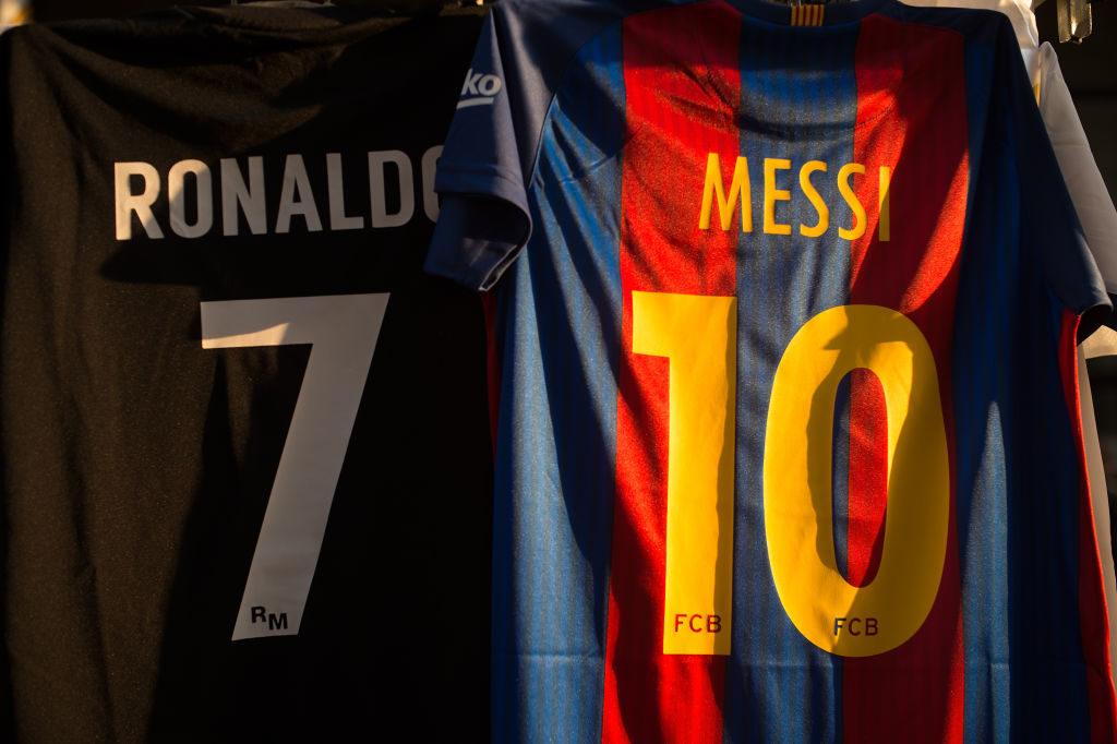MADRID, SPAIN - AUGUST 16: The shirts of Cristiano Ronaldo of Real Madrid CF and Lionel Messi of FC Barcelona are for sale at a stall outside the Santiago Bernabeu stadium ahead of the Supercopa de Espana Final 2nd Leg match between Real Madrid and FC Barcelona at Estadio Santiago Bernabeu on August 16, 2017 in Madrid, Spain. (Photo by Denis Doyle/Getty Images)