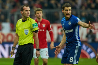 MUNICH, GERMANY - FEBRUARY 04: Referee Marco Fritz and Leon Goretzka of FC Schalke 04 looks on during the Bundesliga match between Bayern Muenchen and FC Schalke 04 at Allianz Arena on February 4, 2017 in Munich, Germany. (Photo by TF-Images/Getty Images)