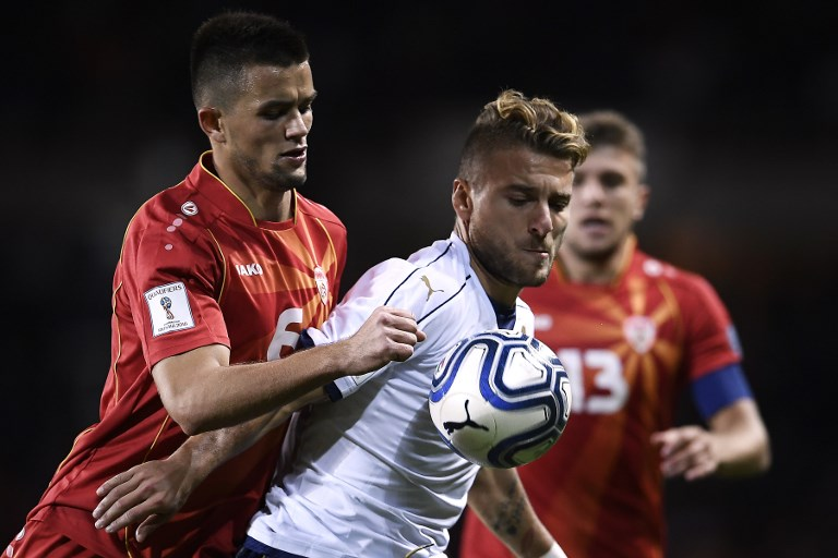 Macedonia's defender Visar Musliu (L) fights for the ball with Italy's midfielder Ciro Immobile during the FIFA World Cup 2018 qualification football match between Italy and Macedonia on October 6, 2017 at the Grande Torino Stadium in Turin.  / AFP PHOTO / MARCO BERTORELLO