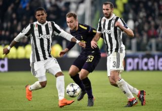 Christian Eriksen of Tottenham is challenged by Douglas Costa of Juventus and Giorgio Chiellini of Juventus during the UEFA Champions League Round of 16 match between Juventus and Tottenham Hotspur at the Juventus Stadium, Turin, Italy on 13 February 2018.  (Photo by Giuseppe Maffia/NurPhoto)