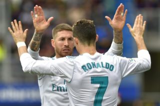 Real Madrid's Portuguese forward Cristiano Ronaldo celebrates with Real Madrid's Spanish defender Sergio Ramos (back) after scoring a goal during the Spanish league football match between Eibar and Real Madrid at the Ipurua stadium in Eibar on March 10, 2018. / AFP PHOTO / ANDER GILLENEA