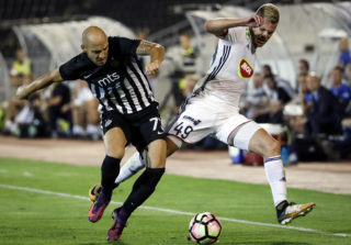BELGRADE, SERBIA - AUGUST 17: Krisztian Geresi (R) of Videoton in action against Nemanja Miletic (L) of Partizan during the UEFA Europa League Qualifying Play-Offs round first leg match between Partizan and Videoton FC at stadium FK Partizan on August 17, 2017 in Belgrade, Serbia. (Photo by Srdjan Stevanovic/Getty Images)