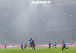 Heavy rain falls during the German First division Bundesliga football match FC Bayern Munich vs Bayer 04 Leverkusen in Munich, southern Germany, on August 18, 2017. / AFP PHOTO / Guenter SCHIFFMANN / RESTRICTIONS: DURING MATCH TIME: DFL RULES TO LIMIT THE ONLINE USAGE TO 15 PICTURES PER MATCH AND FORBID IMAGE SEQUENCES TO SIMULATE VIDEO. == RESTRICTED TO EDITORIAL USE == FOR FURTHER QUERIES PLEASE CONTACT DFL DIRECTLY AT + 49 69 650050  / RESTRICTIONS: DURING MATCH TIME: DFL RULES TO LIMIT THE ONLINE USAGE TO 15 PICTURES PER MATCH AND FORBID IMAGE SEQUENCES TO SIMULATE VIDEO. == RESTRICTED TO EDITORIAL USE == FOR FURTHER QUERIES PLEASE CONTACT DFL DIRECTLY AT + 49 69 650050