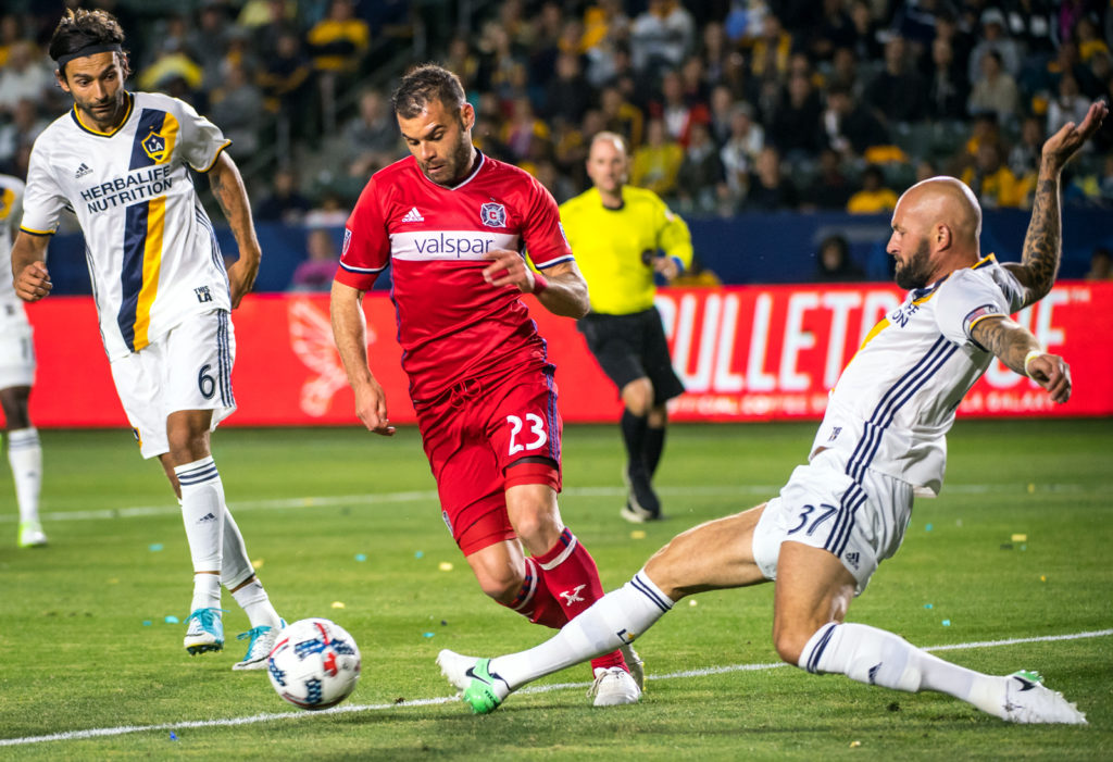 CARSON, CA - MAY 6: Jelle Van Damme #37 of Los Angeles Galaxy clears the ball from Nemanja Nikolic #23 of Chicago Fire but is called for a penalty kick during Los Angeles Galaxy's MLS match against Chicago Fire at the StubHub Center on May 6, 2017 in Carson, California.  The match ended in a 2-2 tie.(Photo by Shaun Clark/Getty Images)
