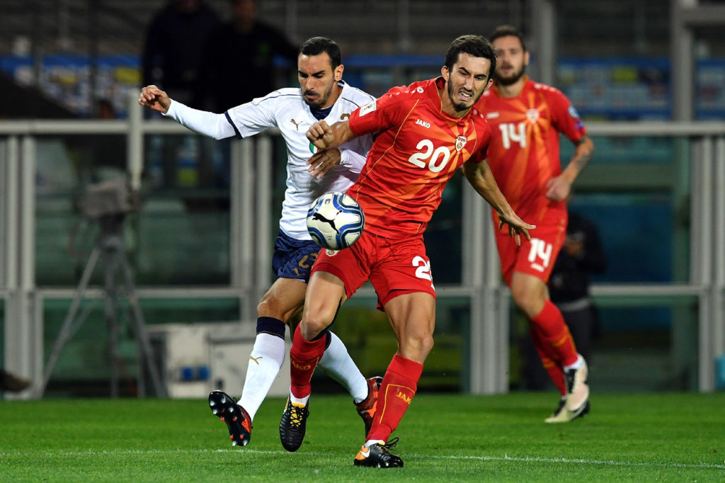 TURIN, ITALY - OCTOBER 06:  Giorgio Chiellini of Italy (L) competes for the ball with Stefan Spirovski of  FYR Macedonia during the FIFA 2018 World Cup Qualifier between Italy and FYR Macedonia at Stadio Olimpico on October 6, 2017 in Turin, Italy .  (Photo by Valerio Pennicino/Getty Images)