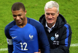 PARIS, FRANCE - NOVEMBER 10:  Kylian Mbappe of France react with Didier Deschamps during the friendly match between France and Wales at Stade de France on November 10, 2017 in Paris, France.  (Photo by Xavier Laine/Getty Images)
