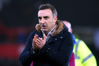 SWANSEA, WALES - JANUARY 02: Swansea City manager Carlos Carvalhal looks dejected after the final whistle of the Premier League match between Swansea City and Tottenham Hotspur at the Liberty Stadium on January 02, 2018 in Swansea, Wales. (Photo by Athena Pictures/Getty Images)