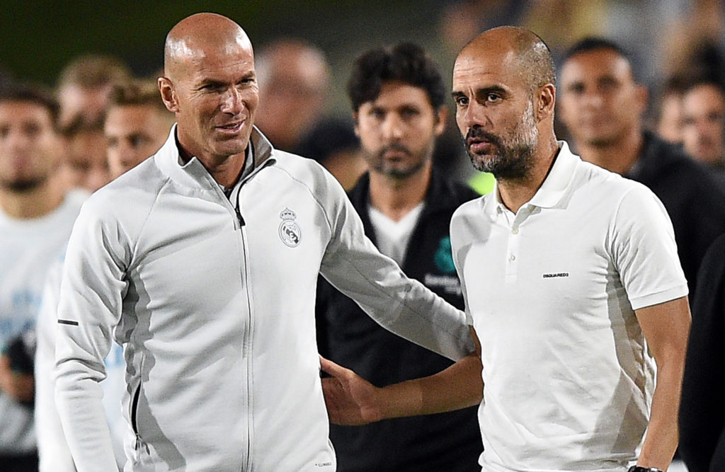 LOS ANGELES, CA - JULY 26: Coach and manager Pep Guardiola (R) of Manchester City and Zinedine Zidane coach of Real Madrid greet after Manchester City defeated Real madrid, 4-1, during the International Champions Cup 2017 at Los Angeles Coliseum July 26, 2017, in Los Angeles, California. (Photo by Kevork Djansezian/Getty Images)