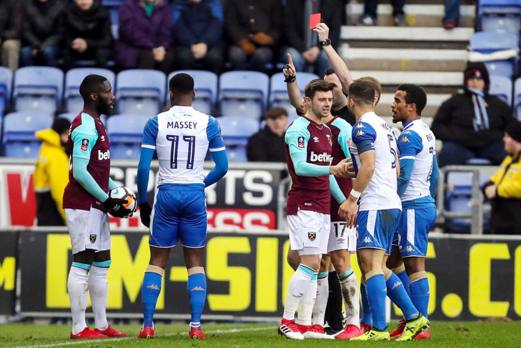 WIGAN, ENGLAND - JANUARY 27: Arther Masuaku of West Ham United gets sent off during the The Emirates FA Cup Fourth Round match between Wigan Athletic and West Ham United on January 27, 2018 in Wigan, United Kingdom. (Photo by Robbie Jay Barratt - AMA/Getty Images)