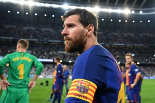 Barcelona's Argentinian forward Lionel Messi looks on after being defeated by Real Madrid at the end of the second leg of the Spanish Supercup football match Real Madrid vs FC Barcelona at the Santiago Bernabeu stadium in Madrid, on August 16, 2017. / AFP PHOTO / GABRIEL BOUYS