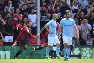 Bournemouth's English midfielder Charlie Daniels (L) celebrates after scoring the opening goal of the English Premier League football match between Bournemouth and Manchester City at the Vitality Stadium in Bournemouth, southern England on August 26, 2017. / AFP PHOTO / Glyn KIRK / RESTRICTED TO EDITORIAL USE. No use with unauthorized audio, video, data, fixture lists, club/league logos or 'live' services. Online in-match use limited to 75 images, no video emulation. No use in betting, games or single club/league/player publications.  /