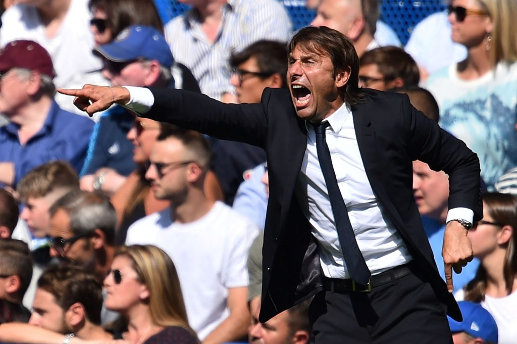 Chelsea's Italian head coach Antonio Conte gestures during the English Premier League football match between Chelsea and Everton at Stamford Bridge in London on August 27, 2017. / AFP PHOTO / Glyn KIRK / RESTRICTED TO EDITORIAL USE. No use with unauthorized audio, video, data, fixture lists, club/league logos or 'live' services. Online in-match use limited to 75 images, no video emulation. No use in betting, games or single club/league/player publications.  /