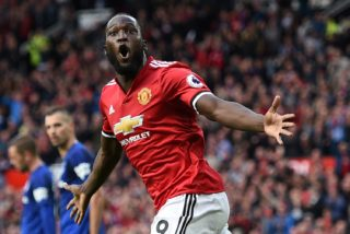 Manchester United's Belgian striker Romelu Lukaku celebrates after scoring their third goal during the English Premier League football match between Manchester United and Everton at Old Trafford in Manchester, north west England, on September 17, 2017. Manchester United won the game 4-0. / AFP PHOTO / Oli SCARFF / RESTRICTED TO EDITORIAL USE. No use with unauthorized audio, video, data, fixture lists, club/league logos or 'live' services. Online in-match use limited to 75 images, no video emulation. No use in betting, games or single club/league/player publications.  /