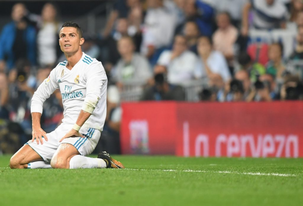 Real Madrid's forward from Portugal Cristiano Ronaldo kneels on the field during the Spanish league football match Real Madrid CF against Real Betis  at the Santiago Bernabeu stadium in Madrid on September 20, 2017. / AFP PHOTO / GABRIEL BOUYS