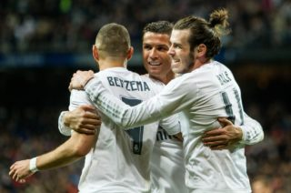SPAIN, Madrid : Real Madrid's Welsh forward Gareth Bale (R), Real Madrid's French forward Karim Benzema (L) and Real Madrid's Portuguese forward Cristiano Ronaldo (C) celebrate scoring during the Spanish league football match Real Madrid CF vs Sevilla FC at the Santiago Bernabeu stadium in Madrid on March 20, 2016.  - CITIZENSIDE/Rodrigo Jimenez