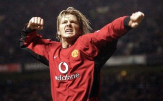 Manchester United's David Beckham celebrates after his shot was rebounded into the goal by Ruud van Nistelrooy against Leeds United during their premiereship clash at Old Trafford in Manchester 05 March 2003. AFP Photo by Paul Barker / AFP PHOTO / PAUL BARKER