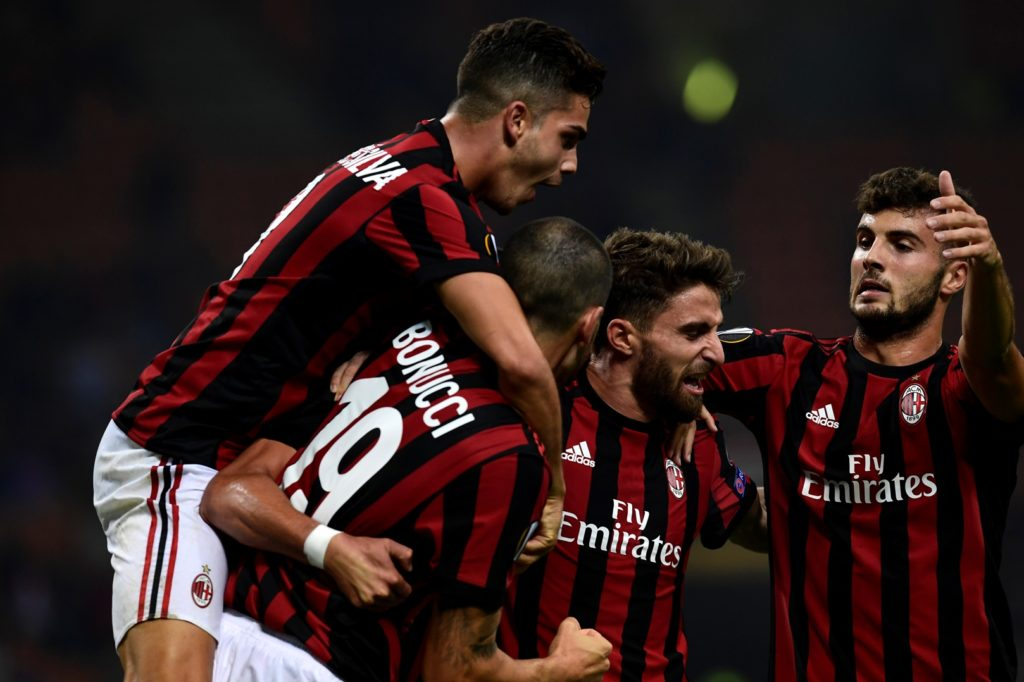 AC Milan's Argentinian defender Mateo Musacchio (hidden) celebrates with teammates after scoring during the UEFA Europa League football match AC Milan vs HNK Rijeka at the San Siro stadium in Milan on September 28, 2017. / AFP PHOTO / MIGUEL MEDINA