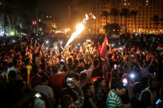 CAIRO, EGYPT - OCTOBER 08: Hundreds of people gather at Tahrir Square during celebrations after Egypt beats Congo during the FIFA 2018 World Cup Qualifiers match and gain right to participate the FIFA 2018 World Cup since 1990, in Cairo, Egypt on October 08, 2017.   Ahmed Al Sayed / Anadolu Agency