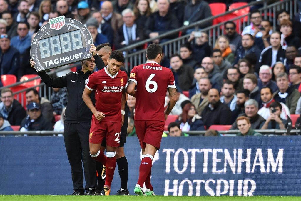 Liverpool's Croatian defender Dejan Lovren (R) is substituted for Liverpool's English midfielder Alex Oxlade-Chamberlain during the English Premier League football match between Tottenham Hotspur and Liverpool at Wembley Stadium in London, on October 22, 2017. / AFP PHOTO / Glyn KIRK / RESTRICTED TO EDITORIAL USE. No use with unauthorized audio, video, data, fixture lists, club/league logos or 'live' services. Online in-match use limited to 75 images, no video emulation. No use in betting, games or single club/league/player publications.  /