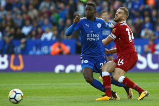 Leicester City's Nigerian midfielder Wilfred Ndidi (L) tackles Liverpool's English midfielder Jordan Henderson during the English Premier League football match between Leicester City and Liverpool at King Power Stadium in Leicester, central England on September 23, 2017. / AFP PHOTO / Geoff CADDICK / RESTRICTED TO EDITORIAL USE. No use with unauthorized audio, video, data, fixture lists, club/league logos or 'live' services. Online in-match use limited to 75 images, no video emulation. No use in betting, games or single club/league/player publications.  /