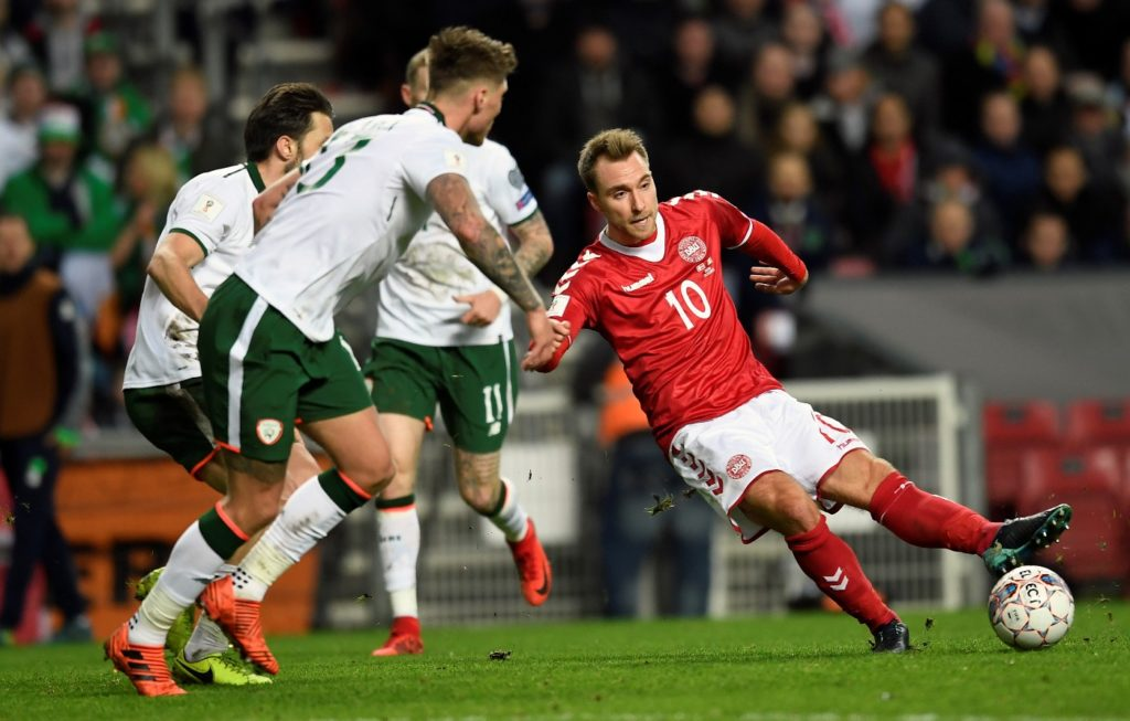 Christian Eriksen (R) of Denmark vies for the ball against Jeff Hendrick and James McClean of Ireland during the play-off FIFA World Cup 2018 qualification football match of Denmark vs the Republic of Ireland on November 11, 2017 at the Telia Parken stadium in Copenhagen. / AFP PHOTO / SCANPIX DENMARK / Lars Moeller