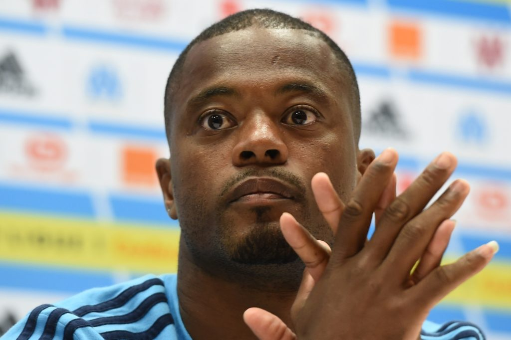 (FILES) This file photo taken on August 23, 2017 shows Marseille's French defender Patrice Evra holding a press conference at the Velodrome Stadium in Marseille, southeastern France, on the eve of the UEFA Europa League play-off football match between Marseille and NK Domzale. Following the UEFA Europa League incident in which Evra kicked a Marseille supporter in the face before a Europa Lague match in Guimaraes, Evra was banned from all European tournaments until June 30, 2018, the UEFA said on November 10, 2017, as his club of Olympique Marseille (OM) said Evra was leaving the OM. / AFP PHOTO / BORIS HORVAT