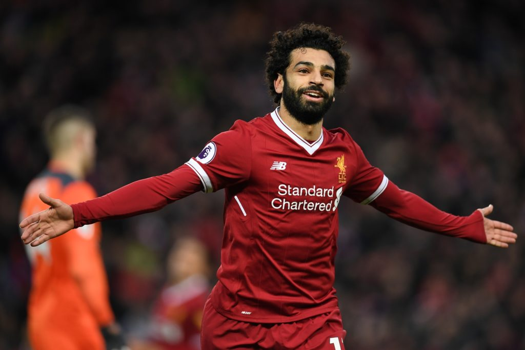 Liverpool's Egyptian midfielder Mohamed Salah celebrates scoring his team's second goal during the English Premier League football match between Liverpool and Southampton at Anfield in Liverpool, north west England on November 18, 2017. / AFP PHOTO / Paul ELLIS / RESTRICTED TO EDITORIAL USE. No use with unauthorized audio, video, data, fixture lists, club/league logos or 'live' services. Online in-match use limited to 75 images, no video emulation. No use in betting, games or single club/league/player publications.  /