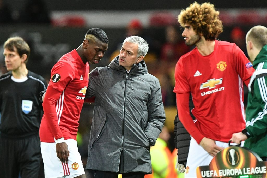 3051357 03/16/2017 Center, from left: Manchester United's Paul Pogba, head coach Jose Mourinho, and Marouane Fellaini during the UEFA Europa League Round of 16 between Manchester United and Rostov Rostov-on-Don. Vladimir Pesnya/Sputnik