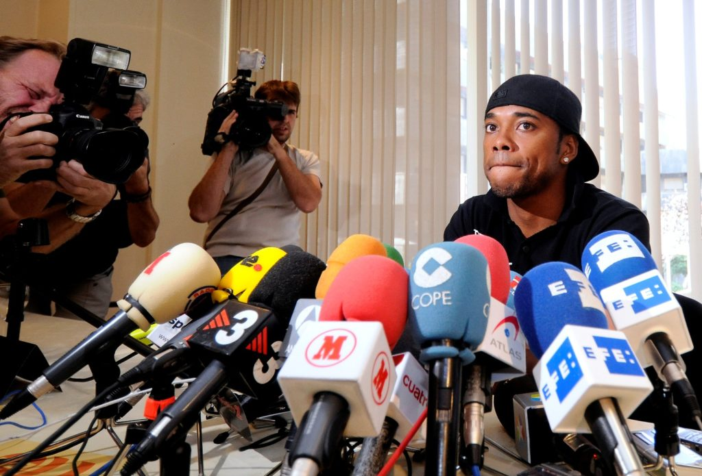 """Real Madrid's Brazilian player Robinho attends a press conference on August 31, 2008 in Madrid. Robinho said that his """"head was at Chelsea"""" and that he was determined to leave the Spanish club despite efforts of team bosses to keep him. I've already told the president (Ramon Calderon), and coach (Bernd Schuster), management and (the media): my head is there (at Chelsea), I want to play over there,"""" the 24-year-old said. AFP PHOTO/ Dani POZO / AFP PHOTO / DANI POZO"""