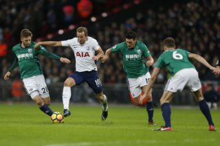 Tottenham Hotspur's English striker Harry Kane (2L) vies with West Bromwich Albion's English midfielder Sam Field (L) and West Bromwich Albion's English midfielder Gareth Barry during the English Premier League football match between Tottenham Hotspur and West Bromwich Albion at Wembley Stadium in London, on November 25, 2017. / AFP PHOTO / Ian KINGTON / RESTRICTED TO EDITORIAL USE. No use with unauthorized audio, video, data, fixture lists, club/league logos or 'live' services. Online in-match use limited to 75 images, no video emulation. No use in betting, games or single club/league/player publications.  /
