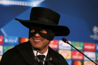 Shakhtar Donetsk's Portuguese manager Paulo Fonseca, wearing a Zorro mask and hat, delivers a press conference after Shakhtar Donetsk won their UEFA Champions League group F football match against Manchester City, at Metalist Stadium in Kharkiv, eastern Ukraine, on December 6, 2017. / AFP PHOTO / Stanislas VEDMID