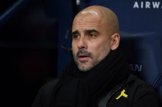 Manchester City's Spanish manager Pep Guardiola looks on before the English Premier League football match between Manchester City and Tottenham Hotspur at the Etihad Stadium in Manchester, north west England, on December 16, 2017. / AFP PHOTO / Paul ELLIS / RESTRICTED TO EDITORIAL USE. No use with unauthorized audio, video, data, fixture lists, club/league logos or 'live' services. Online in-match use limited to 75 images, no video emulation. No use in betting, games or single club/league/player publications.  /