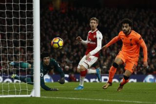 Arsenal's Czech goalkeeper Petr Cech (L) saves a Liverpool's Egyptian midfielder Mohamed Salah pass during the English Premier League football match between Arsenal and Liverpool at the Emirates Stadium in London on December 22, 2017.  / AFP PHOTO / Adrian DENNIS / RESTRICTED TO EDITORIAL USE. No use with unauthorized audio, video, data, fixture lists, club/league logos or 'live' services. Online in-match use limited to 75 images, no video emulation. No use in betting, games or single club/league/player publications.  /