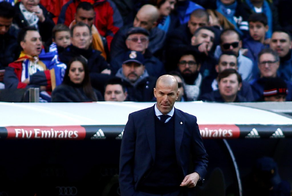"""Real Madrid's French coach Zinedine Zidane reacts during the Spanish League """"Clasico"""" football match Real Madrid CF vs FC Barcelona at the Santiago Bernabeu stadium in Madrid on December 23, 2017.  / AFP PHOTO / OSCAR DEL POZO"""