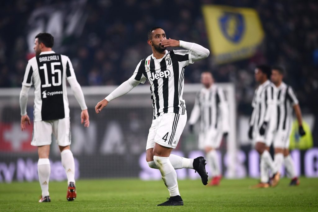 Juventus' defender Medhi Amine Benatia from Morocco celebrates after scoring a goal during the Italian Serie A football match Juventus versus AS Roma on December 23, 2017 at the Allianz Stadium in Turin. / AFP PHOTO / MARCO BERTORELLO