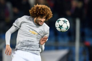 Manchester United's Belgian midfielder Marouane Fellaini heads the ball during the UEFA Champions League Group A football match between FC Basel and Manchester United on November 22, 2017 in Basel. / AFP PHOTO / Fabrice COFFRINI