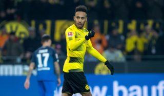 Dortmund's Pierre-Emerick Aubameyang cheers over his 1-1 equalizing score during the German Bundesliga soccer match between Borussia Dortmund and 1899 Hoffenheim at the Signal Iduna Park in Dortmund, Germany, 16 December 2017.   (EMBARGO CONDITIONS - ATTENTION: Due to the accreditation guidelines, the DFL only permits the publication and utilisation of up to 15 pictures per match on the internet and in online media during the match.) Photo: Guido Kirchner/dpa