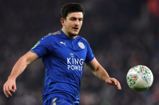 Leicester City's English defender Harry Maguire eyes the ball during the English League Cup quarter-final football match between Leicester City and Manchester City at King Power Stadium in Leicester, central England on December 19, 2017. / AFP PHOTO / Paul ELLIS / RESTRICTED TO EDITORIAL USE. No use with unauthorized audio, video, data, fixture lists, club/league logos or 'live' services. Online in-match use limited to 75 images, no video emulation. No use in betting, games or single club/league/player publications.  /