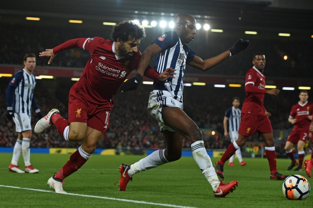 Liverpool's Egyptian midfielder Mohamed Salah (2nd L) vies with West Bromwich Albion's French-born Cameroonian defender Allan Nyom during the English FA Cup fourth round football match between Liverpool and West Bromwich Albion at Anfield in Liverpool, north west England on January 27, 2018. / AFP PHOTO / PAUL ELLIS / RESTRICTED TO EDITORIAL USE. No use with unauthorized audio, video, data, fixture lists, club/league logos or 'live' services. Online in-match use limited to 75 images, no video emulation. No use in betting, games or single club/league/player publications.  /