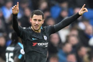Chelsea's Belgian midfielder Eden Hazard celebrates after scoring their third goal during the English Premier League football match between Brighton and Hove Albion and Chelsea at the American Express Community Stadium in Brighton, southern England on January 20, 2018. / AFP PHOTO / Glyn KIRK / RESTRICTED TO EDITORIAL USE. No use with unauthorized audio, video, data, fixture lists, club/league logos or 'live' services. Online in-match use limited to 75 images, no video emulation. No use in betting, games or single club/league/player publications.  /