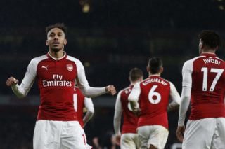Arsenal's Gabonese striker Pierre-Emerick Aubameyang celebrates with teammates scoring the team's fourth goal during the English Premier League football match between Arsenal and Everton at the Emirates Stadium in London on February 3, 2018.  / AFP PHOTO / IKIMAGES / Ian KINGTON / RESTRICTED TO EDITORIAL USE. No use with unauthorized audio, video, data, fixture lists, club/league logos or 'live' services. Online in-match use limited to 45 images, no video emulation. No use in betting, games or single club/league/player publications.  /