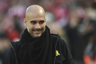 (FILES) In this file photo taken on January 14, 2018 Manchester City's Spanish manager Pep Guardiola arrives for the English Premier League football match between Liverpool and Manchester City at Anfield in Liverpool, north west England. The Football Association has charged on February 23, 2018 Manchester City boss Pep Guardiola for wearing Catalonia political symbol. / AFP PHOTO / Oli SCARFF / RESTRICTED TO EDITORIAL USE. No use with unauthorized audio, video, data, fixture lists, club/league logos or 'live' services. Online in-match use limited to 75 images, no video emulation. No use in betting, games or single club/league/player publications.  /