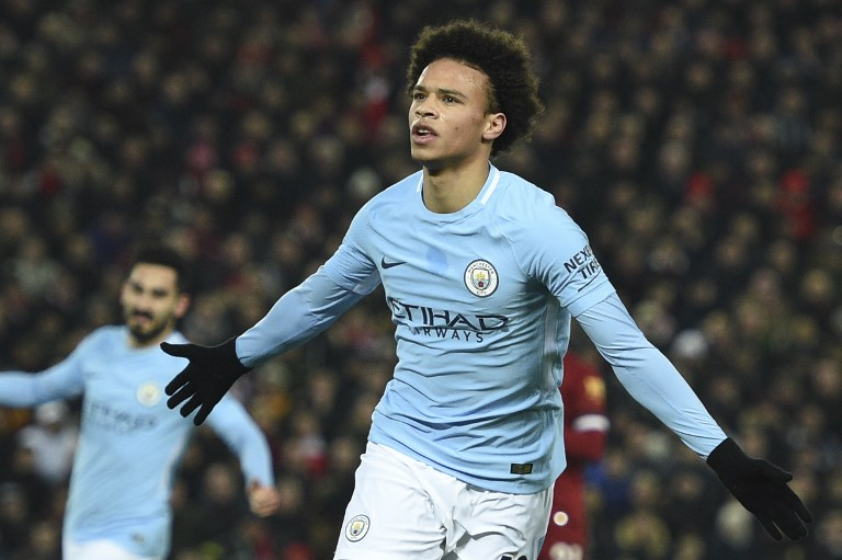 Manchester City's German midfielder Leroy Sane celebrates scoring their first goal to equalise 1-1 during the English Premier League football match between Liverpool and Manchester City at Anfield in Liverpool, north west England on January 14, 2018. / AFP PHOTO / Oli SCARFF / RESTRICTED TO EDITORIAL USE. No use with unauthorized audio, video, data, fixture lists, club/league logos or 'live' services. Online in-match use limited to 75 images, no video emulation. No use in betting, games or single club/league/player publications.  /