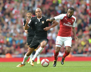 Sevilla's Steven N'Zonzi (L) vies with Arsenal's French striker Alexandre Lacazette during the pre-season friendly football match between Arsenal and Sevilla at The Emirates Stadium in north London on July 30, 2017, the game is one of four matches played over two days for the Emirates Cup. / AFP PHOTO / OLLY GREENWOOD