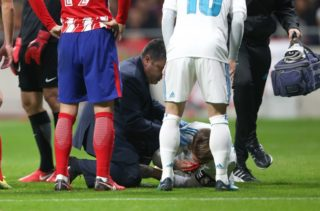 Sergio Ramos of Real Madrid is assisted after being injured during the match between Atletico Madrid and Real Madrid as part of La Liga at Wanda Metropolitano Stadium on November 18, 2017 in Madrid, Spain. (Photo by Raddad Jebarah/NurPhoto)